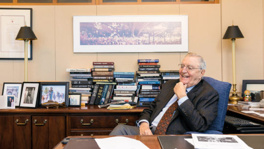 Photo of Walter Mondale sitting at a desk.