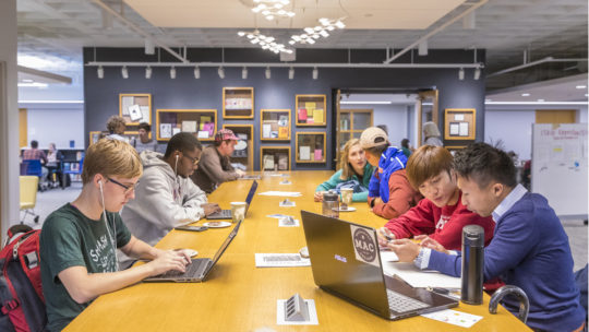 Students study and create on the second floor of the library.