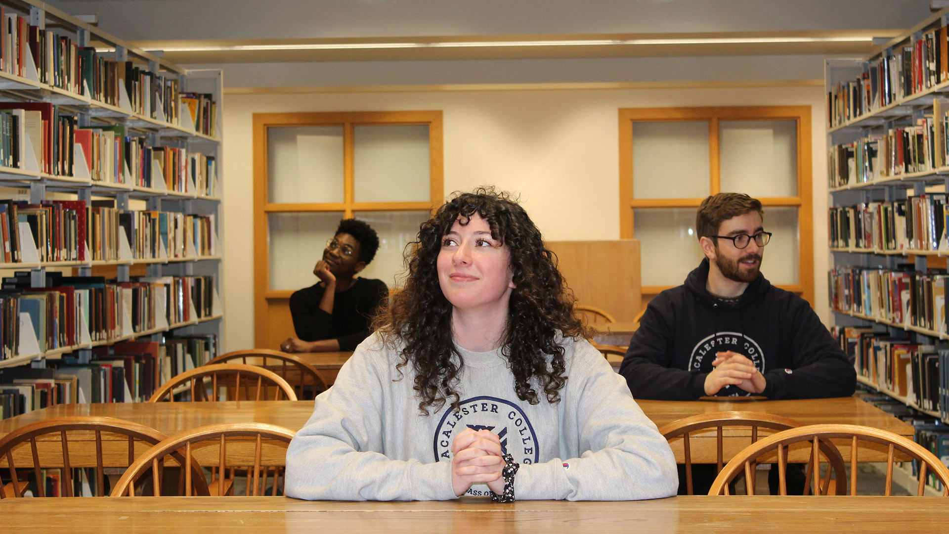 Students physically distancing themselves from each other in the DeWitt Wallace Library.